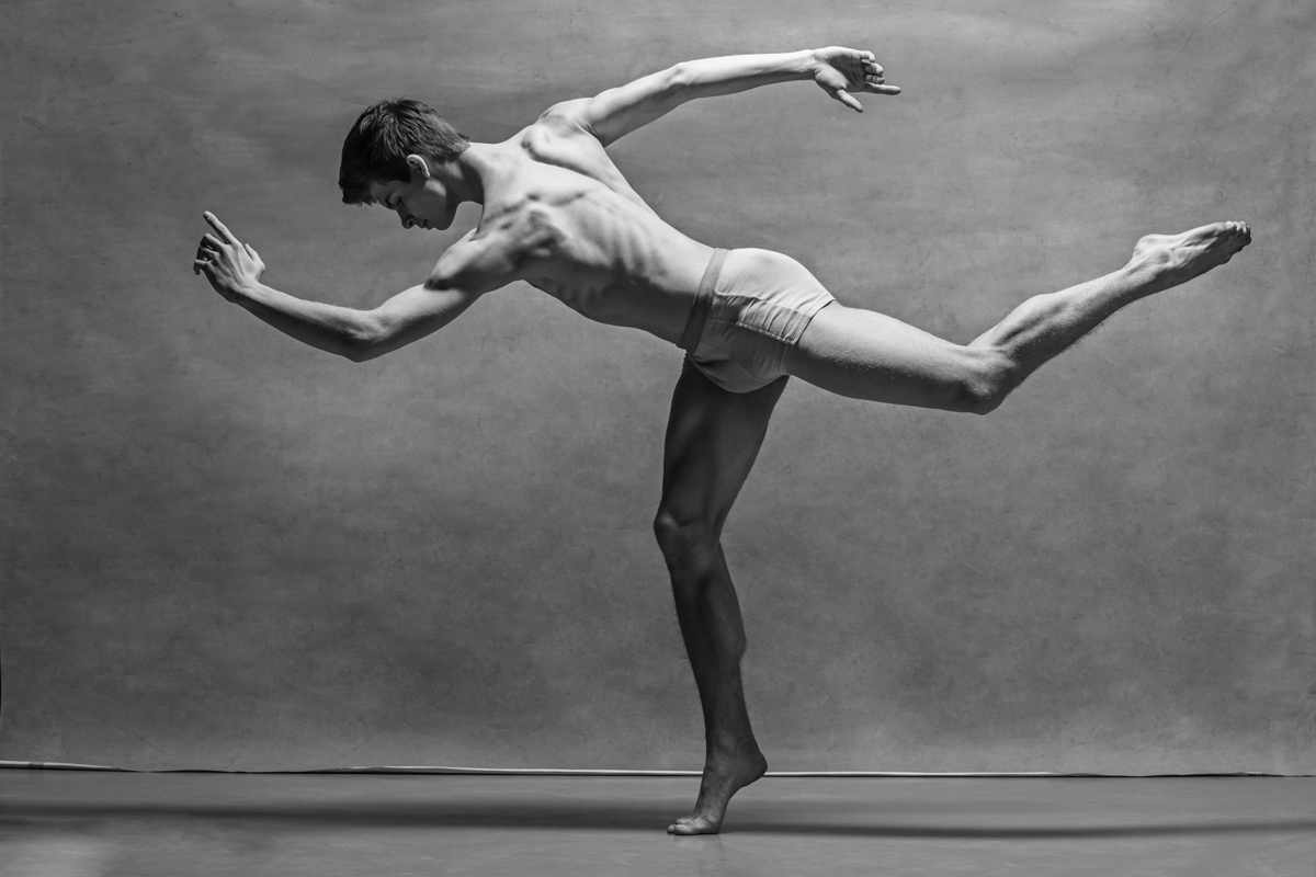 the-male-ballet-dancer-posing-over-gray-P2NSVSC