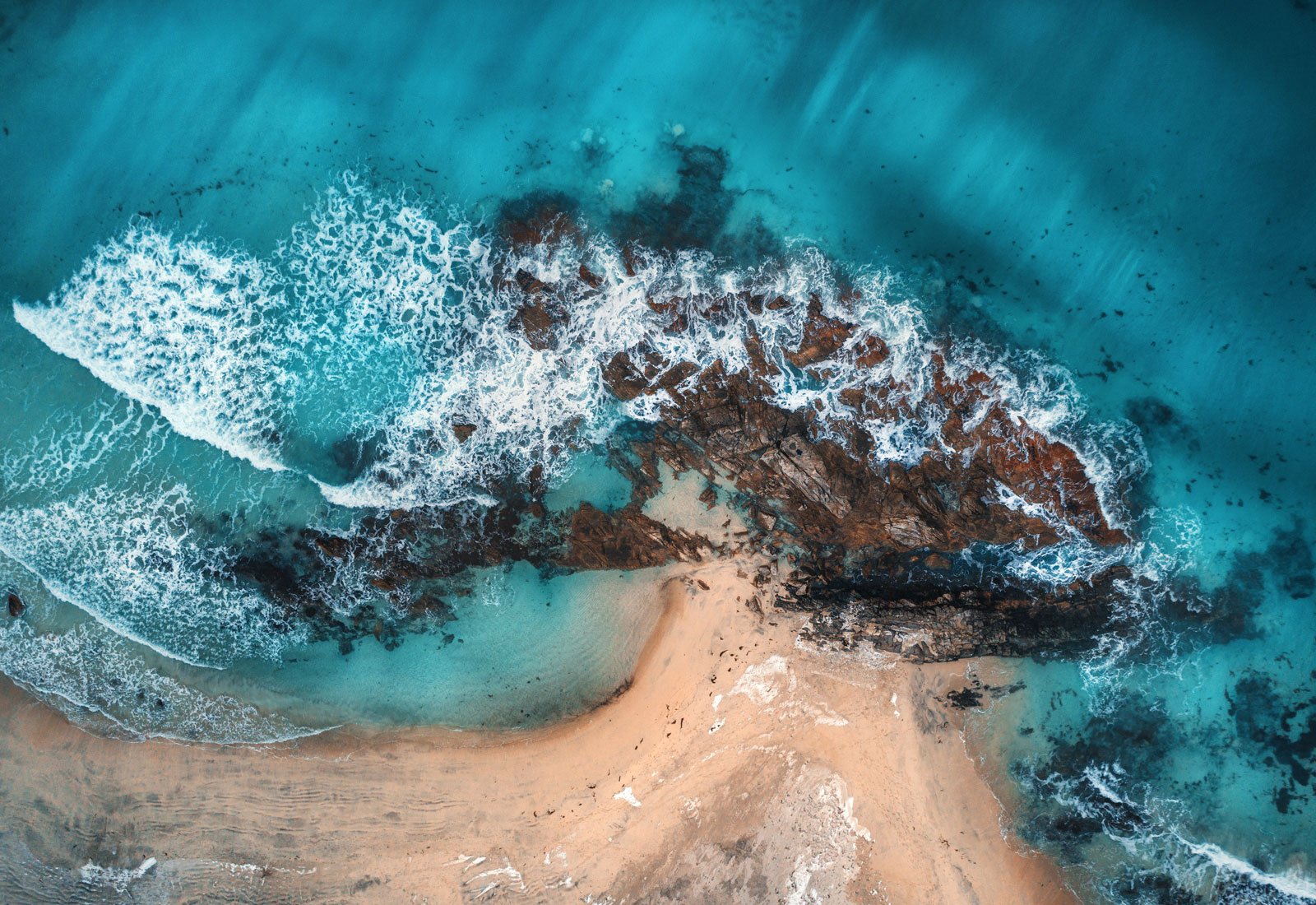 aerial view of waves rocks and transparent sea PYQ8E3R The Plus Addons for Elementor