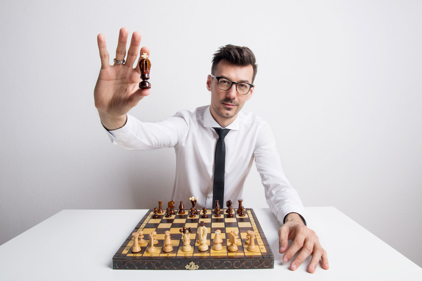 portrait of a young man in a studio playing chess FQJD9ES The Plus Addons for Elementor