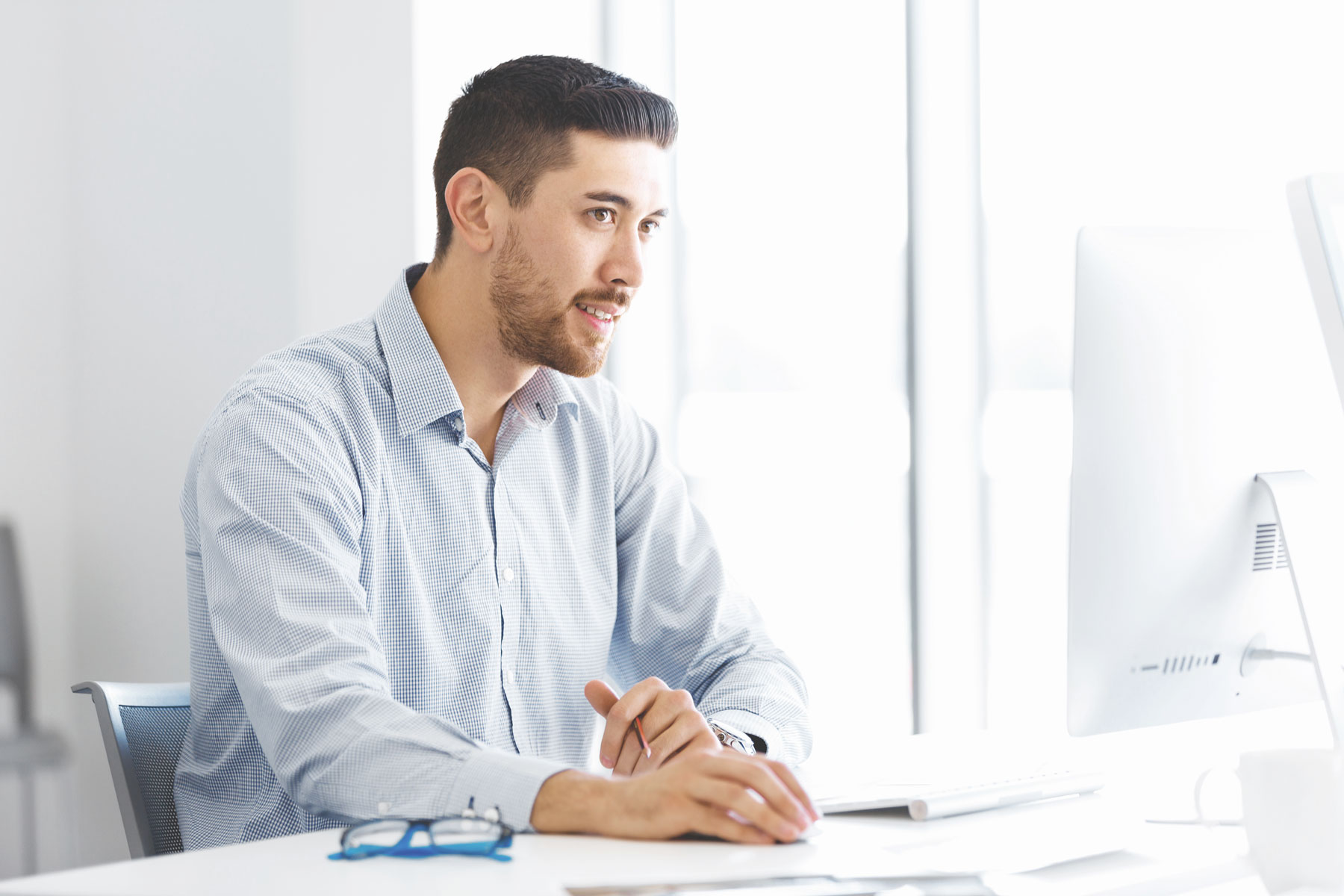 male office worker sitting at desk PNUD6XJ The Plus Addons for Elementor