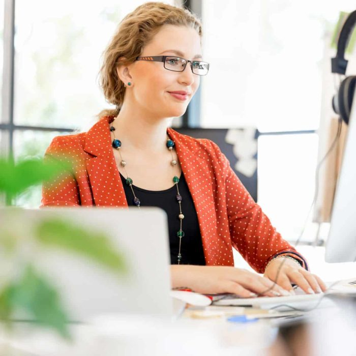 young woman in office The Plus Addons for Elementor