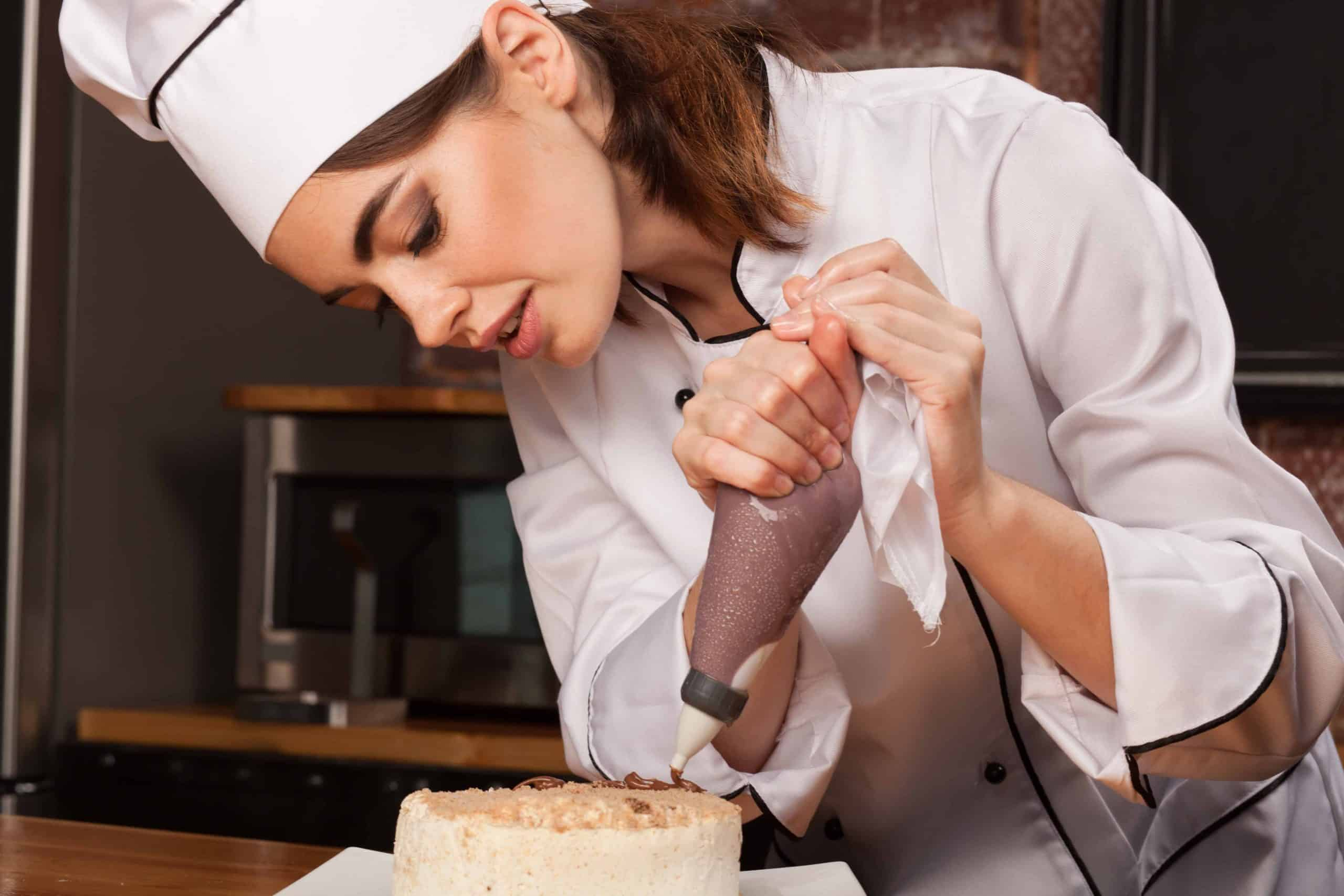 female chef cook preparing a sweet cake in the PFGDRX5 1 scaled The Plus Addons for Elementor